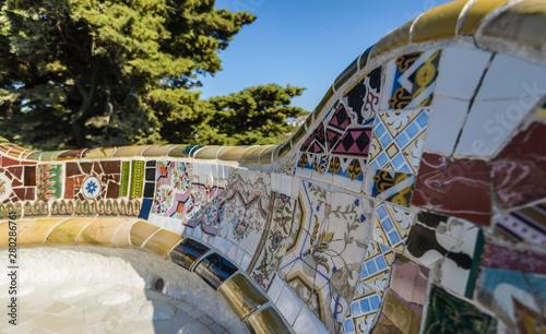 Photo Closeup of mosaic of colored ceramic tile by Antoni Gaudi at his Park Guell, Bar