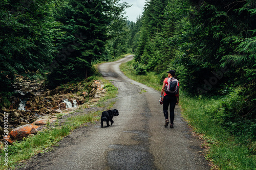 Fototapeta Young woman on the trail in Giant Mountains (Karkonosze), authentic travel experience.  obraz