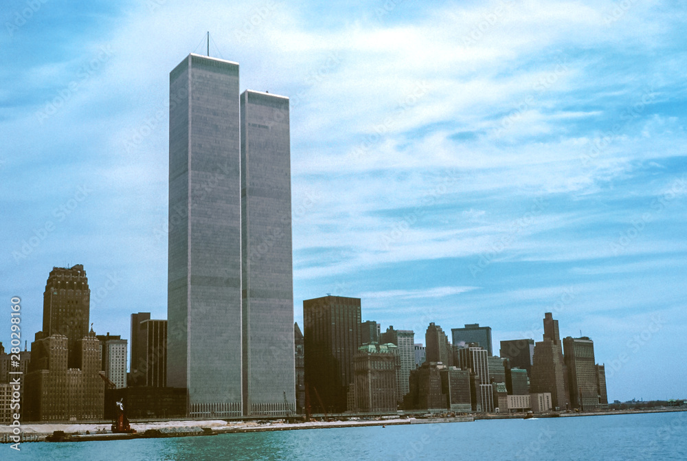 Fototapeta Iconic World Trade Center featured as landmark of the Twin Towers from New Jersey and Hudson River. Archival vintage cityscape of New York city skyline. Manhattan in NYC, United States.