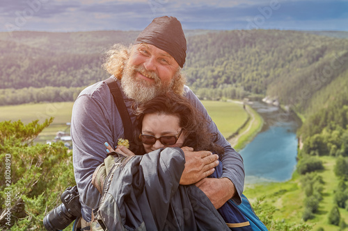 Daughter hugs father on top of a cliff. Slika na platnu