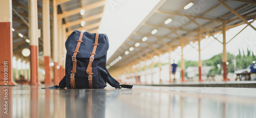 Photo  Backpacks on the floor at train station and copy space