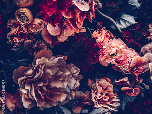 Fotobehang Bloemenwinkel artificial flowers wall background with vintage style
