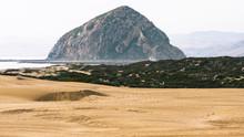 Sand Dunes On The Beach And Morro Rock. Morro Bay Dunes, California Coastline