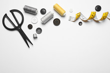 Composition With Scissors And Other Sewing Accessories On White Background, Top View