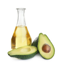 Bottle Of Natural Oil And Avocados Isolated On White