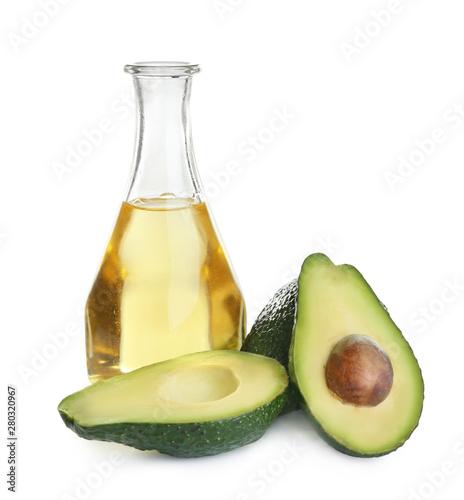 Fototapeta Bottle of natural oil and avocados isolated on white obraz