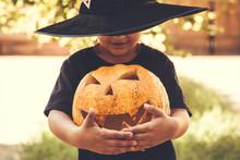 Boy Holding Halloween Pumpkin