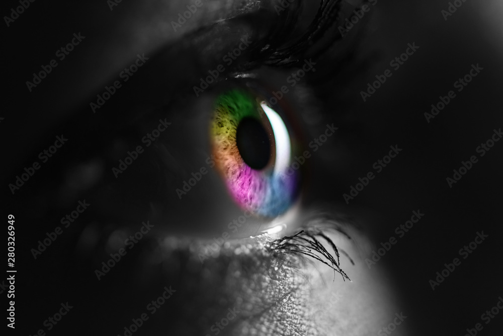 Fototapeta black and white shot of human with bright rainbow colors eye