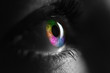 canvas print picture - black and white shot of human with bright rainbow colors eye