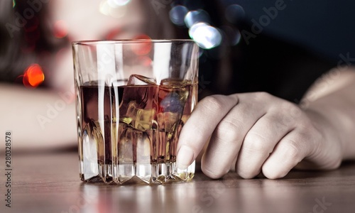 Young beautiful woman in depression, is drinking alcohol.abuse and alcoholic concept