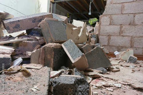 Demolished breeze block interior wall inside a factory. Part of a reconstruction project.  Building site rubble