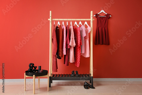 Valokuvatapetti Rack with hanging clothes in interior of dressing room