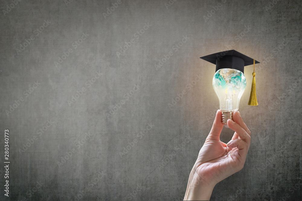 Fototapeta Innovative learning, creative educational study concept for graduation and school student success with world lightbulb on teacher chalkboard