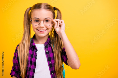 Closeup photo of little lady return school eager get knowledge wear specs new bag checkered shirt isolated yellow background