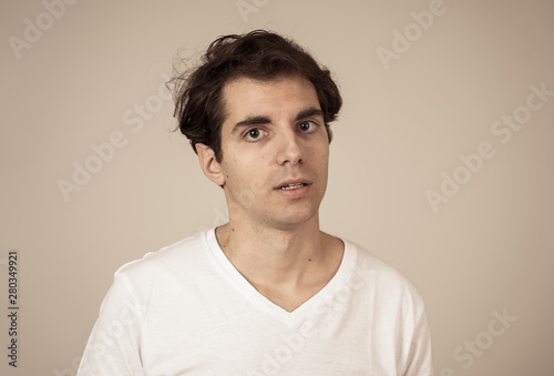 Carta da parati Portrait of a handsome young man with furious face looking disgusted