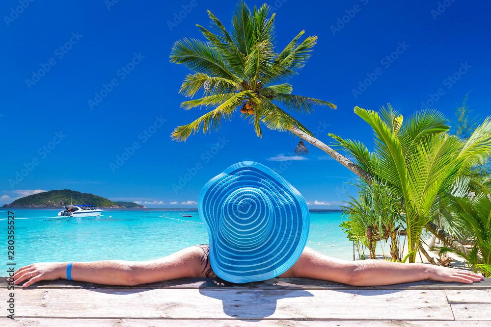 Fototapeta Woman in hat at beautiful Caribbean sea, Mexico
