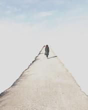 Woman Walking Along A Path Tow...
