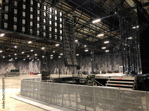 Photo Installation of professional sound speakers, line array and stage equipment for a concert