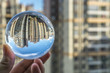 canvas print picture - round Glass ball with big city buildings background