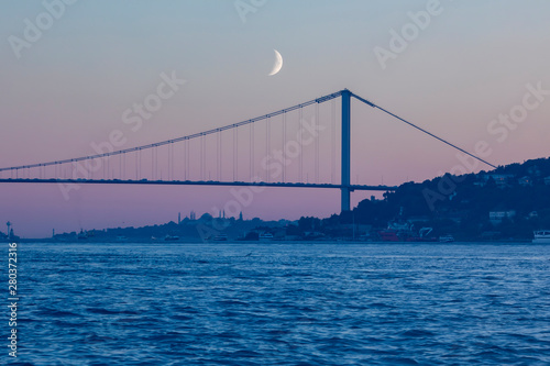 Cuadros en Lienzo Night Cityscape and Seascape , Moon,  Istanbul Bosphorus Bridge