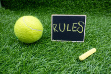 Rules Of Tennis With Tennis Ball Are On Green Grass