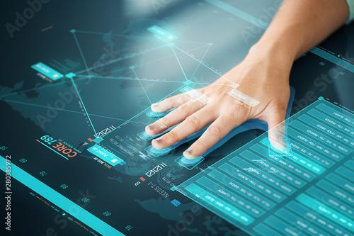 Fotografija  future technology, data access and identification concept - hand using interacti