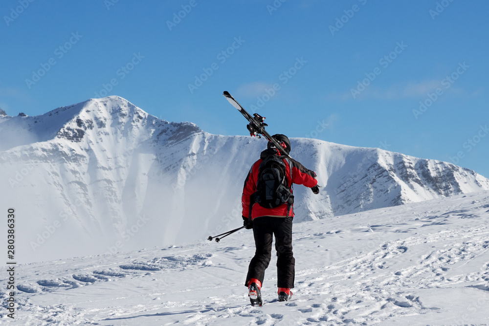 Fototapety, obrazy: Skier with skis go up to top of mountain
