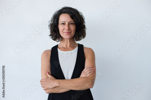 Fototapeta Cheerful middle aged woman with curly hair
