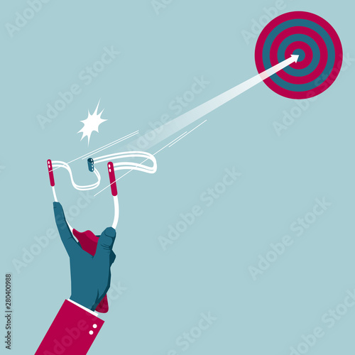 Shoot with a slingshot. Isolated on blue background. Tablou Canvas