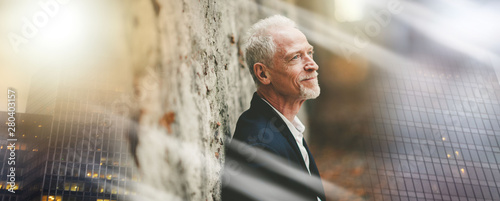 Portrait of handsome mature man, light effect; multiple exposure