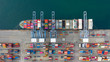 Leinwandbild Motiv Aerial view container ship carrying container in import export business logistic and transportation of international by container ship in the open sea, with copy space.
