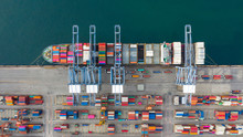 Aerial View Container Ship Carrying Container In Import Export Business Logistic And Transportation Of International By Container Ship In The Open Sea, With Copy Space.