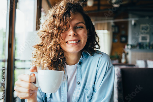 Fotografie, Obraz  Happy young woman with curly hair