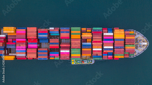 Foto auf Leinwand Shanghai Container ship carrying container aerial view, Business import and export logistic and transportation of international by container ship in the open sea, with copy space.