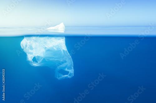 Obraz na plátně  plastic bag floating at water, iceberg metaphor