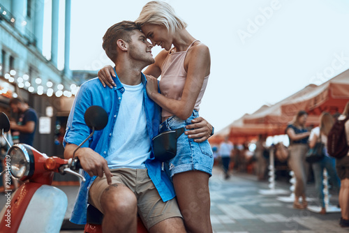 Obraz Romantic couple head to head hugging at the fair - fototapety do salonu