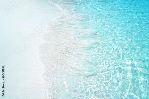 Foto auf Gartenposter Wasser Transparent blue waves on a sandy beach