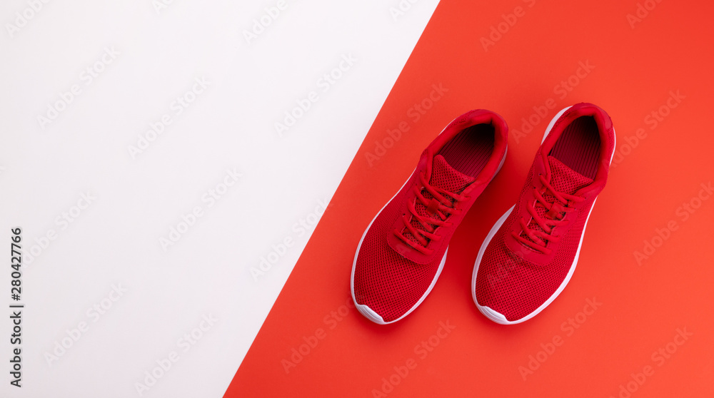 Fototapeta A studio shot of running shoes on bright color background. Flat lay.
