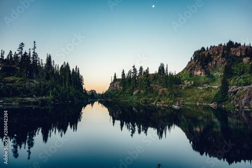 Photo  Pre-dawn sunrise over Lila Lake in the Alpine Lakes Wilderness