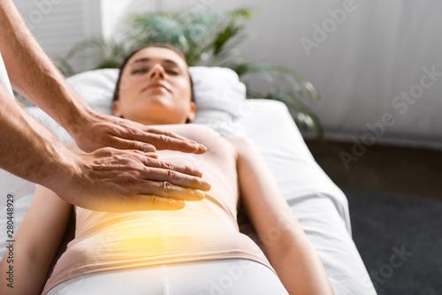 cropped view of healer standing near woman and holding hands above her stomach Tapéta, Fotótapéta