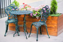 Wrought Iron Table And Chairs In The Garden