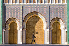 Moroccan Man With Sunglasses And Suit Next To Royal Palace In Fe