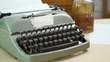 old gray typewriter and blank paper