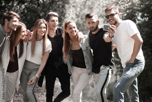 group of happy young men pointing at you.