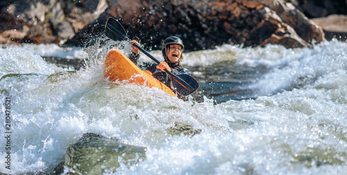 Guy in kayak sails mountain river Canvas Print