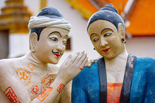 Wat Phumin NAN ,THAILAND The Famous Mural Statue Painting Of A Man Whispering To The Ear Of A Woman. At Wat Phumin, A Famous Temple In Nan Province, Thailand.