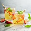Leinwandbild Motiv Iced green tea with strawberries and basil