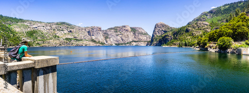 Photo  Hetch Hetchy reservoir on a sunny summer day; Wapama and Tueeulala Falls visible
