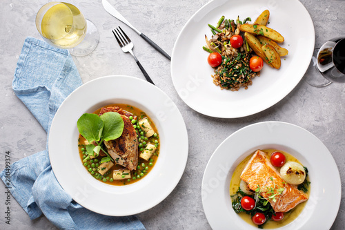 Fotografie, Tablou Spring lunch trio of salmon, chicken and vegetarian dish