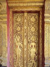 "Low Relief Carved Door ""Wat Mai Suwan Phu Pha Nam"" Is A Temple"